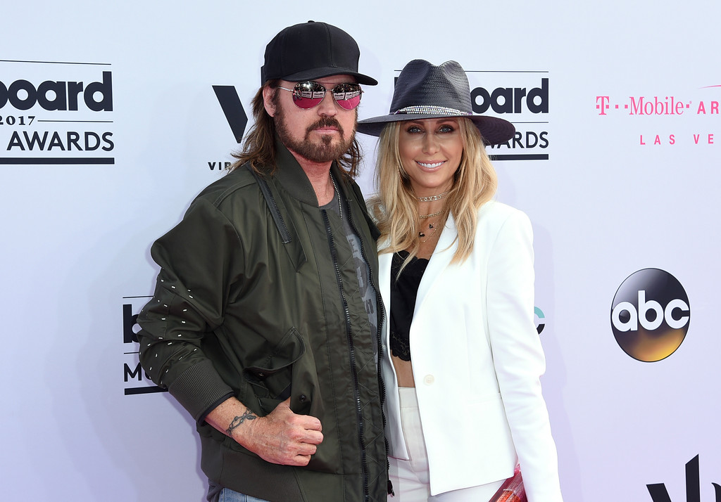 . Billy Ray Cyrus, left, and Tish Cyrus arrive at the Billboard Music Awards at the T-Mobile Arena on Sunday, May 21, 2017, in Las Vegas. (Photo by Richard Shotwell/Invision/AP)