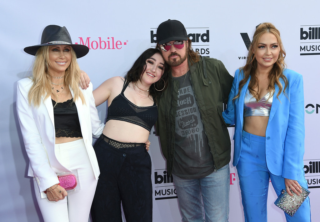 . Tish Cyrus, from left, Noah Cyrus, Billy Ray Cyrus and Brandi Glenn Cyrus arrive at the Billboard Music Awards at the T-Mobile Arena on Sunday, May 21, 2017, in Las Vegas. (Photo by Richard Shotwell/Invision/AP)