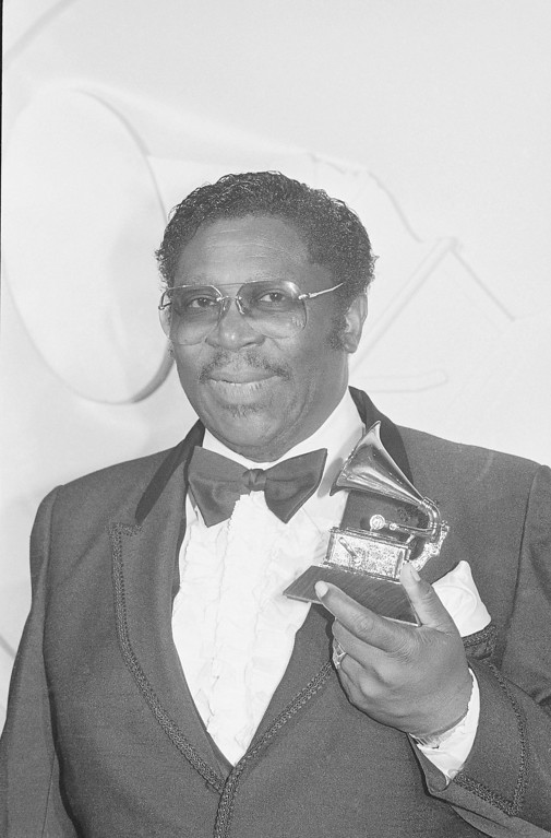 ". Blues king B.B. King stands with his victrola-shaped trophy he received Wednesday night, February 24, 1982 during the 24th annual Grammy Awards presentations in Los Angeles. King was awarded the honor for best ethnic or traditional recording for his rendition of ""There Must Be a Better World Somewhere.\"" (AP Photo/Reed Saxon)"