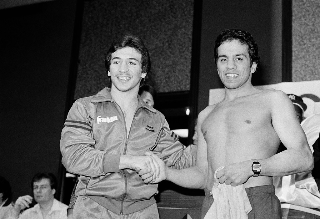 . File - WBA lightweight champ Ray Mancini, left, and Bobby Chacon shake hands during the weigh-in at Reno, Nev. Jan. 14, 1984. Chacon, the pride of Pacoima, lost his last fight Wednesday, September 7, 2016, when he died at age 64.  (AP Photo/Walt Zeboski)