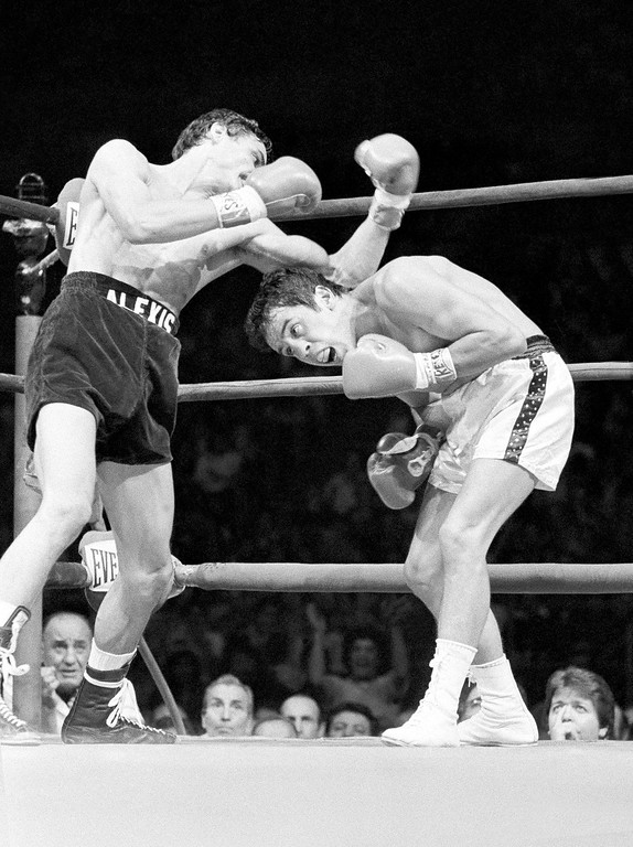 . Featherweight boxer Bobby Chacon, right, ducks a left roundhouse punch from Alexis Arguello during early round action in the World Boxing Council super featherweight championship fight Friday, Nov. 17, 1979 in Los Angeles. Chacon, the pride of Pacoima, lost his last fight Wednesday, September 7, 2016, when he died at age 64.  (AP Photo)