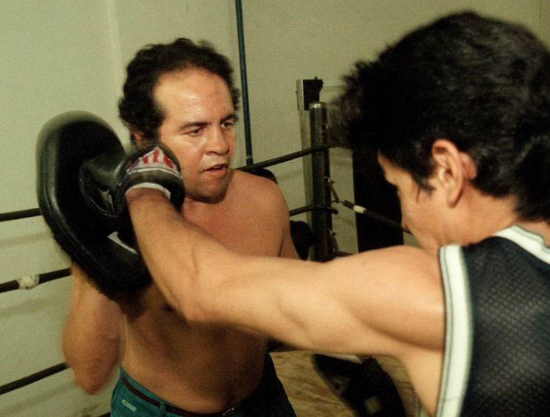 . Boxer Bobby Chacon works the hand mitts with Reynaldo Luna at the gym in the Huntington Hotel in downtown Los Angeles where he trains on Saturday, September 16, 2000. (SGVN/Staff photo by Bernardo Alps/Sports)
