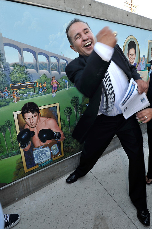 . File - Bobby Chacon demonstrates the reason why he was added to the mural. The newly constructed and opened Northeast Valley Neighborhood City Hall located at 13520 Van Nuys Blvd, celebrated the unveiling of a Mural commemorating the diversity of leaders who have emerged from the Northeast Valley community.  These include writers, sports figures, artists, musicians, community leaders and non-profit organizers. The specially commissioned mural was painted by Los Angeles artist Ignacio Gomez. Pacoima, Ca 7-26-2011. Chacon, the pride of Pacoima, lost his last fight Wednesday, September 7, 2016, when he died at age 64. (John McCoy/Staff Photographer)