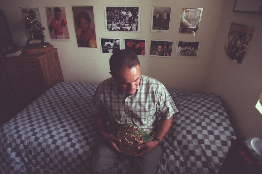 . In this 2001 file photo, former boxing champion Bobby Chacon holds his title belt while taking a moment in his room to reflect on life in Pacoima, California. (Hans Gutknecht/Los Angeles Daily News)