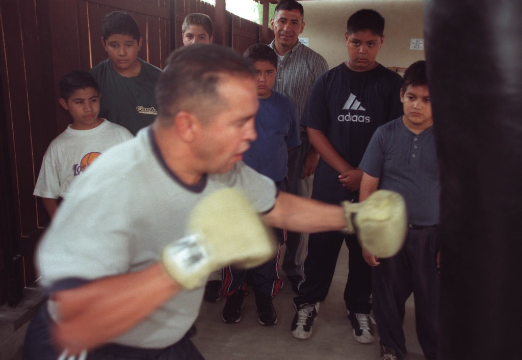 . 2001 file photo: Former world champion boxer Bobby Chacon demonstrates his boxing skills at Hillside Bible Baptist Church for children and Rev Ray Ramirez in Pacoima, California. (Hans Gutknecht/Los Angeles Daily News)