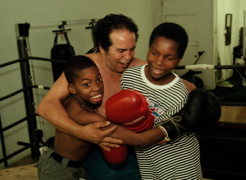 . Boxer Bobby Chacon playfully referees a friendly bout between Antonio King, 12, and Jamaal Lumpkins, 13, at the gym in the Huntington Hotel in downtown Los Angeles on Saturday, September 16, 2000. (SGVN/Staff photo by Bernardo Alps/Sports)