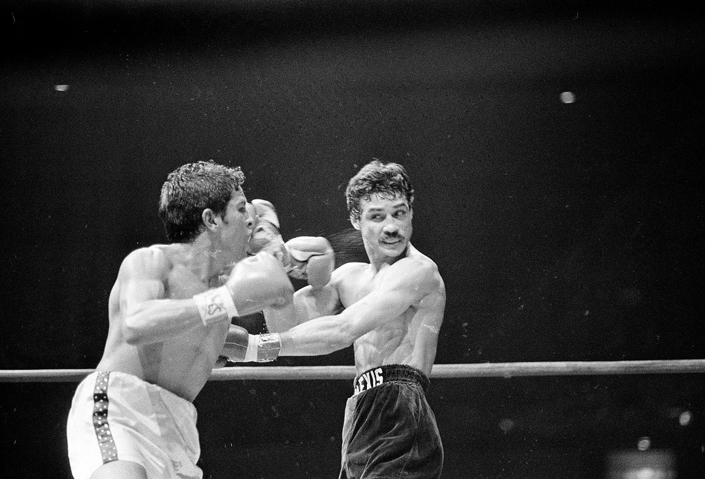 . Alexis Arguello, right, serves up a right hand punch after being hit by the left hand of Bobby Chacon in the fourth round in Los Angeles, Nov. 16, 1979.  Arguello scored a seventh-round knockout to retain his title. Chacon, the pride of Pacoima, lost his last fight Wednesday, September 7, 2016, when he died at age 64.  (AP Photo)