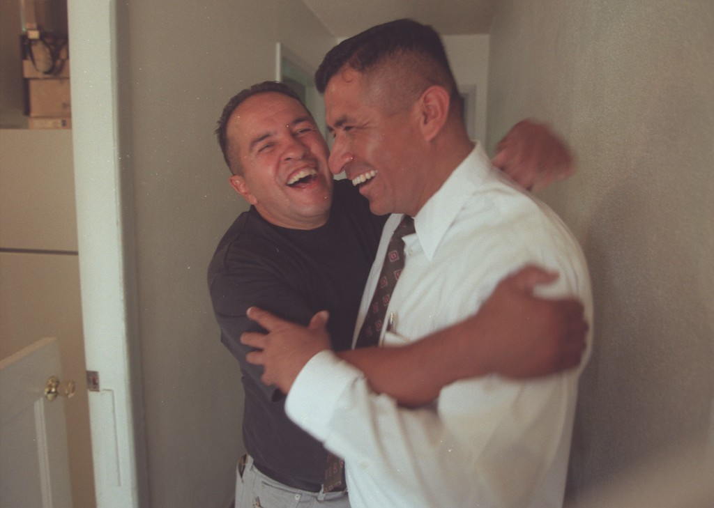 . In this 2001 file photo, former boxing champion Bobby Chacon, left, gives the Rev. Ray Ramirez a big hug at Hillside Bible Baptist Church in Pacoima, California. (Hans Gutknecht/Los Angeles Daily News)