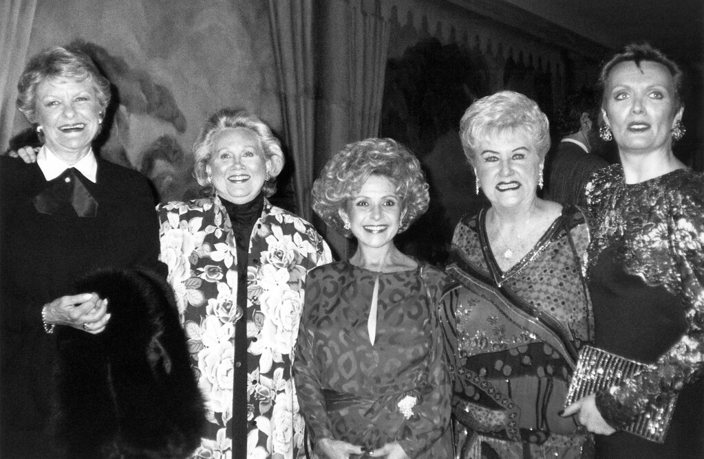 ". File - Honored singers, from left to right are Elaine Stritch, Barbara Cook, Brenda Lee, Margaret Whiting and Maureen McGovern pose for photographers while being feted at the New York for The Hard of Hearing dinner at the Hotel Pierre in New York, May 25, 1990. The benefit, for the ""Legendary Ladies of Song\"" was to raise money for an anti-noise center. (AP Photo/Aubrey Reuben)"