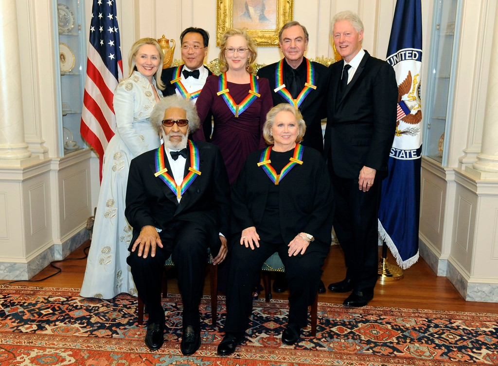 . Secretary of State Hillary Rodham Clinton, left, and President Bill Clinton, right, pose with the 2011 Kennedy Center Honorees, front row from left, Sonny Rollins, Barbara Cook, back row from left, Yo-Yo Ma, Meryl Streep and Neil Diamond at the State Department followoing a dinner and reception on Saturday, Dec. 3, 2011 in Washington. (AP Photo/Kevin Wolf)