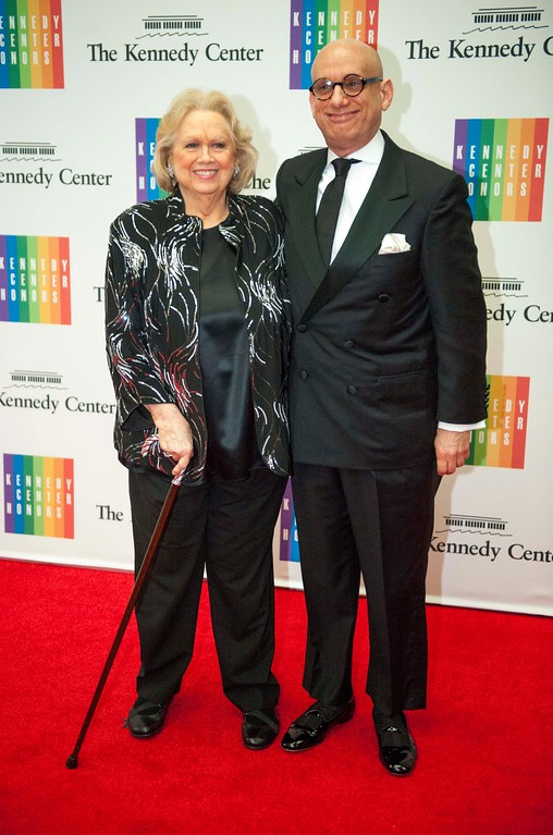 . Former Kennedy Center Honoree Barbara Cook and Adam Le Grant arrive at the State Department for the Kennedy Center Honors gala dinner on Saturday, Dec. 7, 2013 in Washington. (AP Photo/Kevin Wolf)
