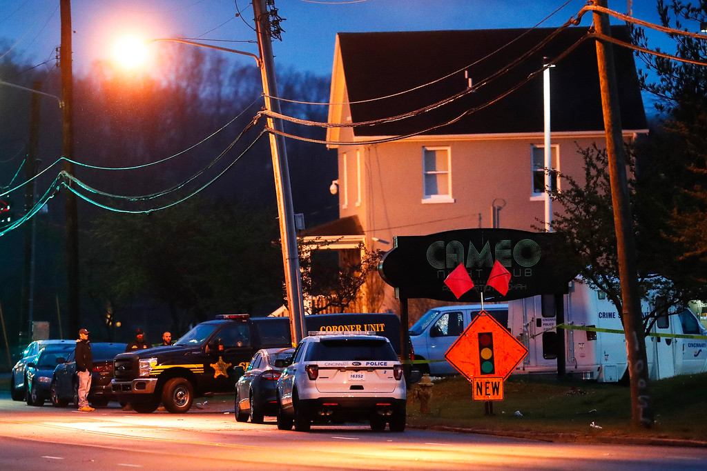 . A coroner\'s unit pulls away as police operate at a crime scene outside the Cameo club after a fatal shooting, Sunday, March 26, 2017, in Cincinnati. (AP Photo/John Minchillo)
