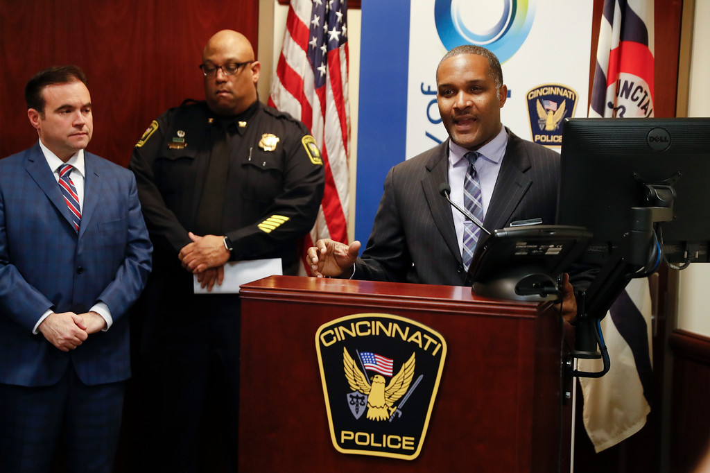 . Cincinnati assistant fire chief Roy Winston speaks alongside police chief Eliot Isaac, center left, and mayor John Cranley during a news conference at police headquarters regarding a fatal shooting at the Cameo Nightclub, Sunday, March 26, 2017, in Cincinnati. At least two people opened fire inside a crowded nightclub early Sunday morning, killing one person and wounding more than a dozen others in what authorities described as a chaotic scene. (AP Photo/John Minchillo)