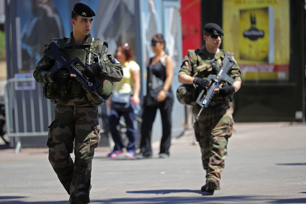 . CANNES, FRANCE - MAY 17:  Armed soldiers patrol The Croisette on the first day of the 70th annual Cannes Film Festival at the Palais des Festivals on May 17, 2017 in Cannes, France. Celebrities, fans and the movie world are descending on Cannes for this year\'s festival of the screen which begins today.  (Photo by Christopher Furlong/Getty Images)