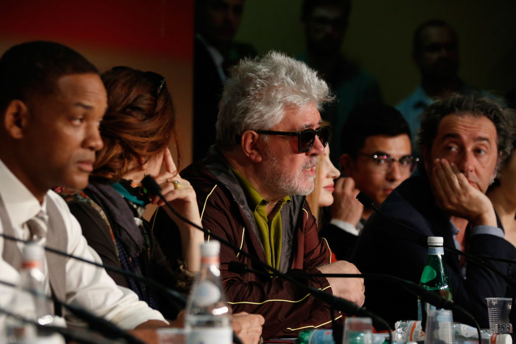 . CANNES, FRANCE - MAY 17:  Jury member Will Smith listens (L) and Jury member Paolo Sorrentino (R) listen as President of the jury Pedro Almodovar (C) speaks during the Jury press conference during the 70th annual Cannes Film Festival at Palais des Festivals on May 17, 2017 in Cannes, France.  (Photo by Pool - Getty Images)