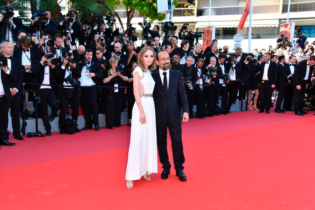 . French-US actress and model Lily-Rose Depp (L) and Iranian director Asghar Farhadi pose as they arrive on May 17, 2017 for the screening of the film \'Ismael\'s Ghosts\' (Les Fantomes d\'Ismael) during the opening ceremony of the 70th edition of the Cannes Film Festival in Cannes, southern France.  (ALBERTO PIZZOLI/AFP/Getty Images)