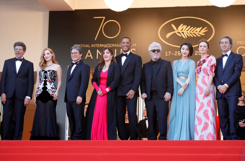 ". CANNES, FRANCE - MAY 17:  (L-R) Jury members  Gabriel Yared, Jessica Chastain, Park Chan-wook, Agnes Jaoui and Will Smith, President of the jury Pedro Almodovar and jury members Fan Bingbing, Maren Ade and Paolo Sorrentino attend the ""Ismael\'s Ghosts (Les Fantomes d\'Ismael)\"" screening and Opening Gala during the 70th annual Cannes Film Festival at Palais des Festivals on May 17, 2017 in Cannes, France.  (Photo by Andreas Rentz/Getty Images)"