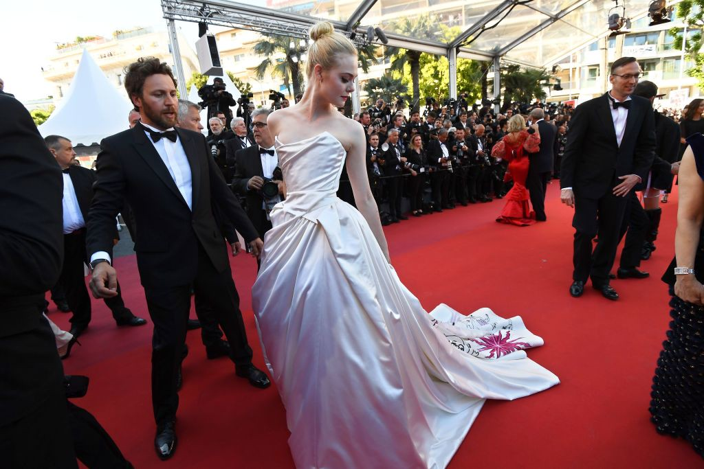 . US actresses Elle Fanning poses as she arrives on May 17, 2017 for the screening of the film \'Ismael\'s Ghosts\' (Les Fantomes d\'Ismael) during the opening ceremony of the 70th edition of the Cannes Film Festival in Cannes, southern France.  (ANNE-CHRISTINE POUJOULAT/AFP/Getty Images)
