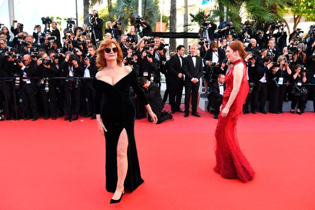 . US actress Susan Sarandon (L) and US actress Julianne Moore pose as they arrive on May 17, 2017 for the screening of the film \'Ismael\'s Ghosts\' (Les Fantomes d\'Ismael) during the opening ceremony of the 70th edition of the Cannes Film Festival in Cannes, southern France.  (ALBERTO PIZZOLI/AFP/Getty Images)