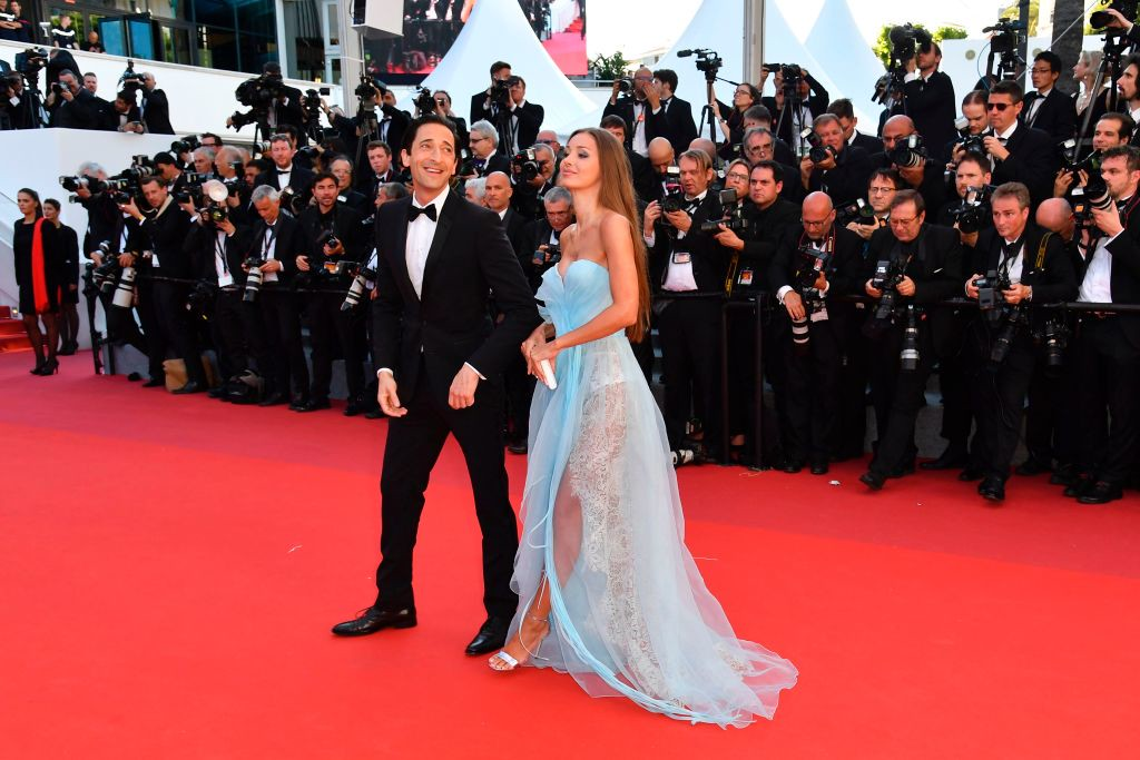 . US actor Adrien Brody (L) and his partner Lara Lieto pose as they arrive on May 17, 2017 for the screening of the film \'Ismael\'s Ghosts\' (Les Fantomes d\'Ismael) during the opening ceremony of the 70th edition of the Cannes Film Festival in Cannes, southern France.  (ALBERTO PIZZOLI/AFP/Getty Images)