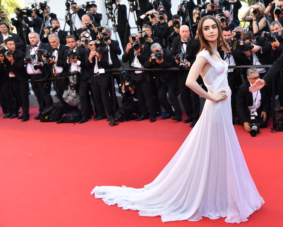 . British actress Lily Collins poses as she arrives on May 19, 2017 for the screening of the film \'Okja\' at the 70th edition of the Cannes Film Festival in Cannes, southern France.  (ALBERTO PIZZOLI/AFP/Getty Images)