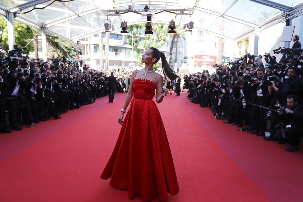 . US model Bella Hadid poses as she arrives on May 19, 2017 for the screening of the film \'Okja\' at the 70th edition of the Cannes Film Festival in Cannes, southern France.  (VALERY HACHE/AFP/Getty Images)