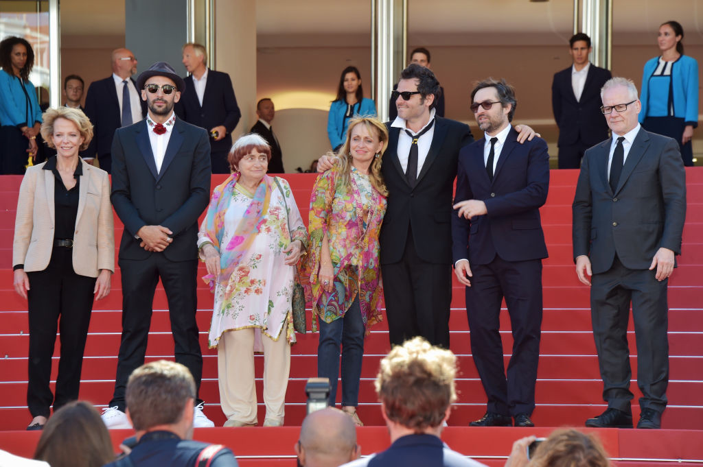 """. CANNES, FRANCE - MAY 19:  Frederique Bredin (L), directors JR, Agnes Varda, composer Matthieu Chedid and members of the cast attend the \""""Faces, Places (Visages, Villages)\"""" screening during the 70th annual Cannes Film Festival at Palais des Festivals on May 19, 2017 in Cannes, France.  (Photo by Pascal Le Segretain/Getty Images)"""