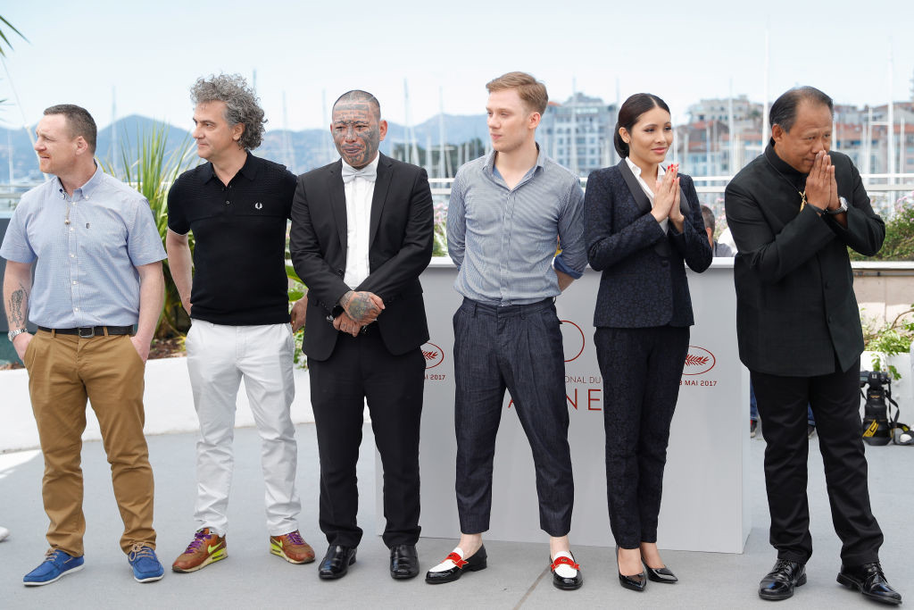 ". CANNES, FRANCE - MAY 19:  (L-R) Billy Moore, Jean-Stéphane Sauvaire, Panya Yimumphai, Joe Cole, Pornchanok Mabklang, Vithaya Pansringarm attend the ""A Prayer Before Dawn\"" photocall during the 70th annual Cannes Film Festival at Palais des Festivals on May 19, 2017 in Cannes, France.  (Photo by Andreas Rentz/Getty Images)"