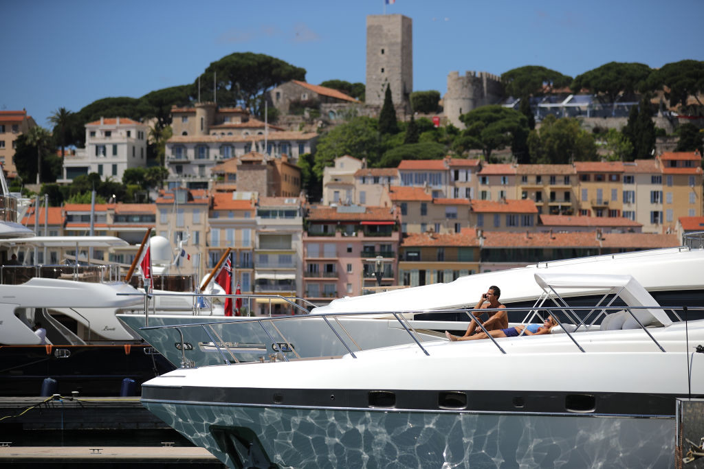 . CANNES, FRANCE - MAY 19:  Luxury yachts berth next to the Palais de Festivals as owners and movie company\'s chartering the yachts attend the Cannes Film Festival on May 19, 2017 in Cannes, France. Celebrities, fans and the movie world have descended on Cannes for this year\'s festival of the screen. For seventy years The Croisette Boulevard has always been the centre of athe place watch the rich and dandy and people from all walks of life to promenade.  (Photo by Christopher Furlong/Getty Images)