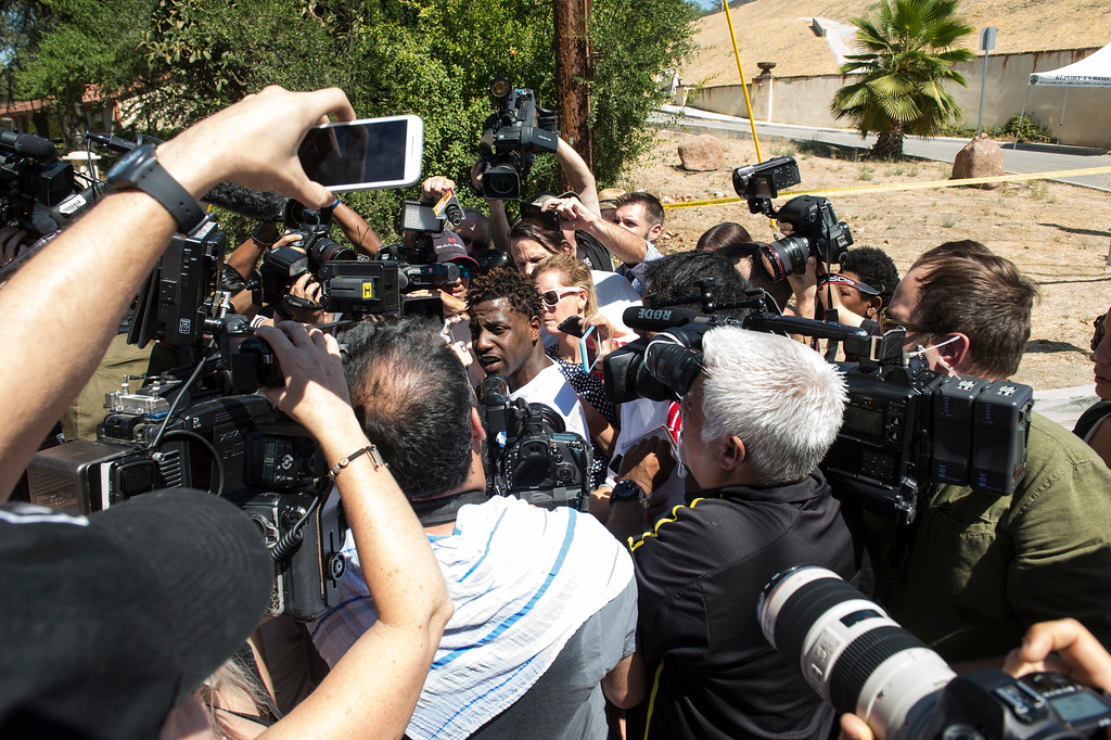 . A man who just left entertainer Chris Brown\'s home is surrounded by the media at the 5000 block Corbin Ave in Tarzana CA on Tuesday, August 30, 2016. (Photo by ED CRISOSTOMO, STAFF PHOTOGRAPHER)