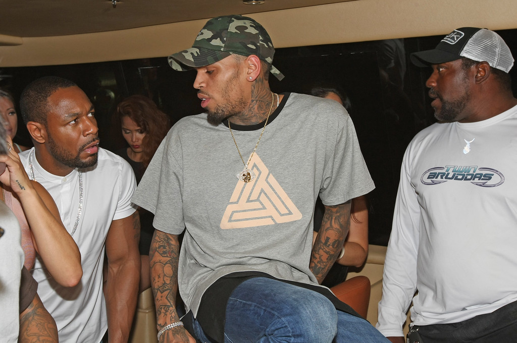 . FORT LAUDERDALE, FL - MAY 15: Chris Brown talks with Recording Artist Tank and Former NFL Player Warren Sapp at the WizPak Launch Party Hosted By Chris Brown on May 15, 2016 in Fort Lauderdale, Florida.  (Photo by Mychal Watts/Getty Images for WizPak )
