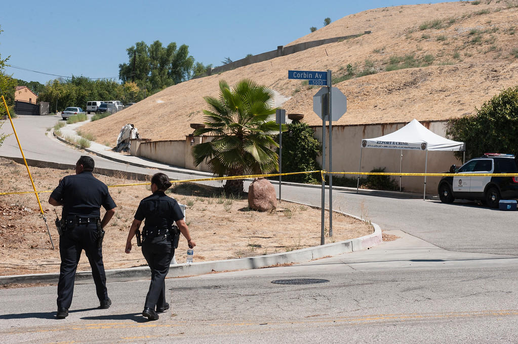 . Los Angeles Police Officers Chris Ramirez and Liliana Preciado head toward the driveway entrance to entertainer Chris Brown\'s home at the 5000 block Corbin Ave in Tarzana CA on Tuesday, August 30, 2016. (Photo by ED CRISOSTOMO, STAFF PHOTOGRAPHER)