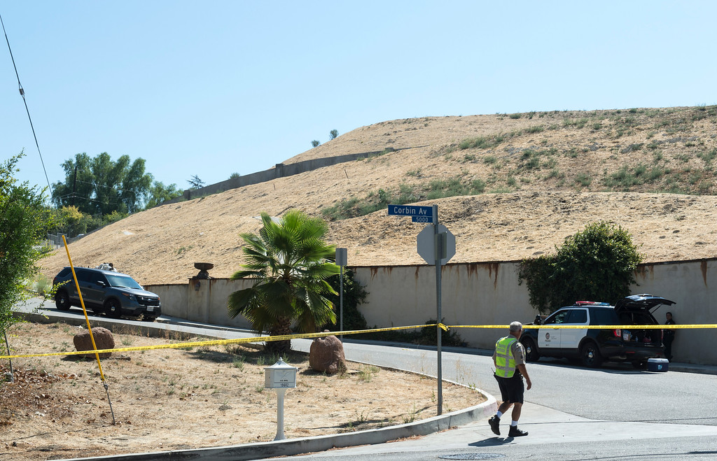 . Los Angeles Police Officers blocks the driveway entrance to entertainer Chris Brown\'s home at the 5000 block Corbin Ave in Tarzana CA on Tuesday, August 30, 2016. (Photo by ED CRISOSTOMO, STAFF PHOTOGRAPHER)