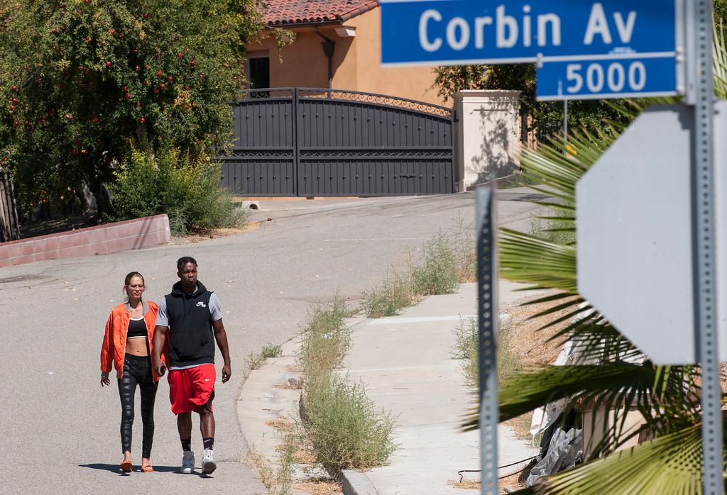 . A man and woman leaves entertainer Chris Brown\'s home at the 5000 block Corbin Ave in Tarzana CA on Tuesday, August 30, 2016. (Photo by ED CRISOSTOMO, STAFF PHOTOGRAPHER)