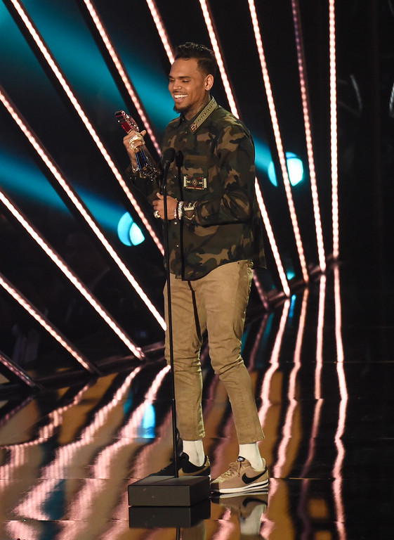 . Chris Brown accepts the award for R&B artist of the year during the iHeartRadio Music Awards at The Forum on Sunday, April 3, 2016, in Inglewood, Calif. (Photo by Chris Pizzellol/Invision/AP)