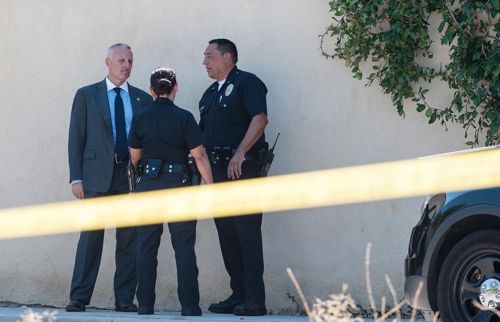 . Los Angeles Police Officers gather near entertainer Chris Brown\'s home at the 5000 block Corbin Ave in Tarzana CA on Tuesday, August 30, 2016. (Photo by ED CRISOSTOMO, STAFF PHOTOGRAPHER)