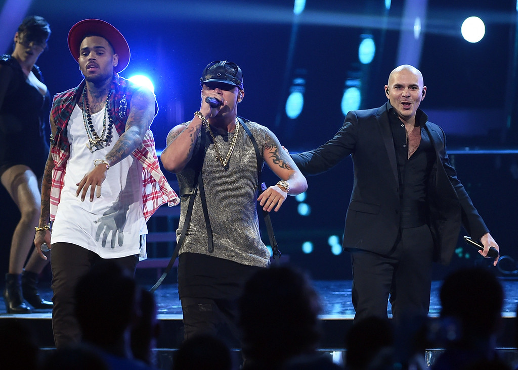 . LAS VEGAS, NV - NOVEMBER 20:  (L-R) Recording artists Chris Brown, Wisin and Pitbull perform during the 15th annual Latin GRAMMY Awards at the MGM Grand Garden Arena on November 20, 2014 in Las Vegas, Nevada.  (Photo by Ethan Miller/Getty Images)