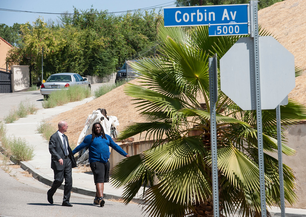 . An officer walks with a man leaving entertainer Chris Brown\'s home at the 5000 block Corbin Ave in Tarzana CA on Tuesday, August 30, 2016. (Photo by ED CRISOSTOMO, STAFF PHOTOGRAPHER)