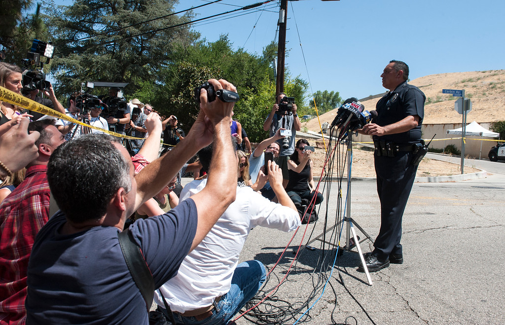 . Los Angeles Police Officers Chris Ramirez addresses the media near entertainer Chris Brown\'s home at the 5000 block Corbin Ave in Tarzana CA on Tuesday, August 30, 2016. (Photo by ED CRISOSTOMO, STAFF PHOTOGRAPHER)