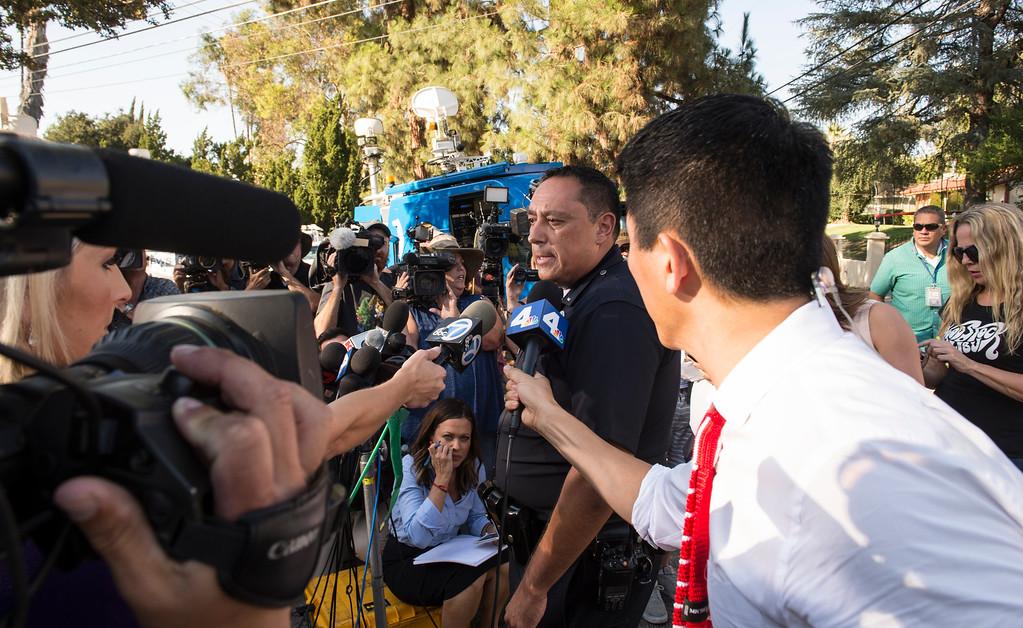 . Los Angeles Police Lt., Chris Ramirez addresses the media near entertainer Chris Brown\'s home at the 5000 block Corbin Ave in Tarzana CA on Tuesday, August 30, 2016. (Photo by ED CRISOSTOMO, STAFF PHOTOGRAPHER)