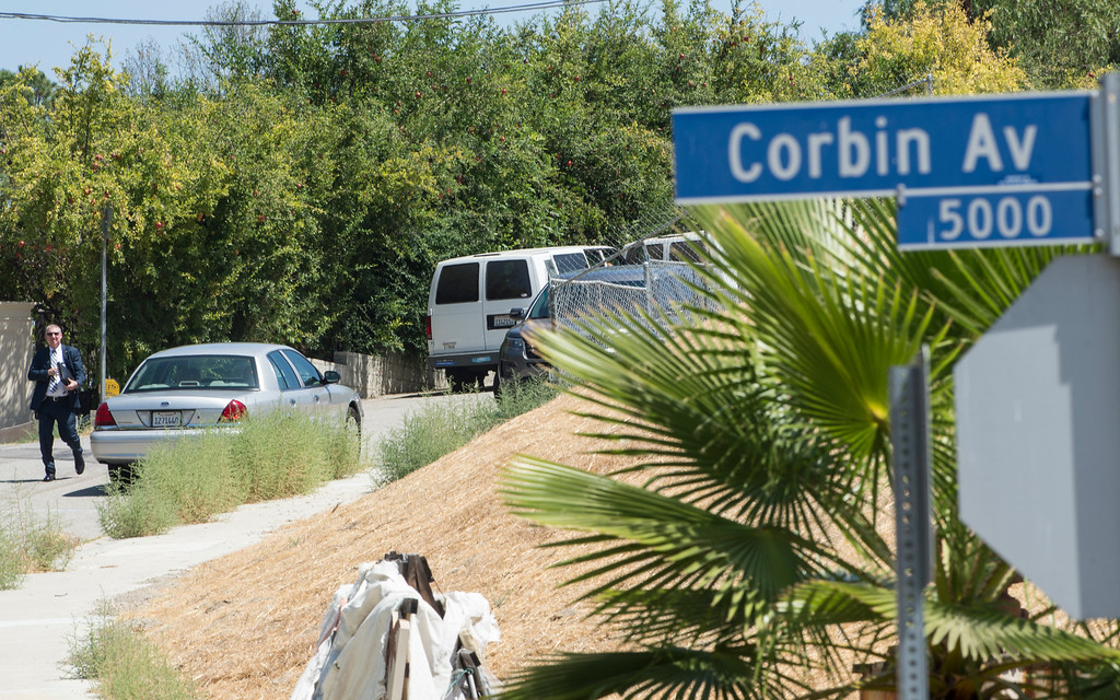 . An Officer walks along the driveway entrance to entertainer Chris Brown\'s home at the 5000 block Corbin Ave in Tarzana CA on Tuesday, August 30, 2016. (Photo by ED CRISOSTOMO, STAFF PHOTOGRAPHER)