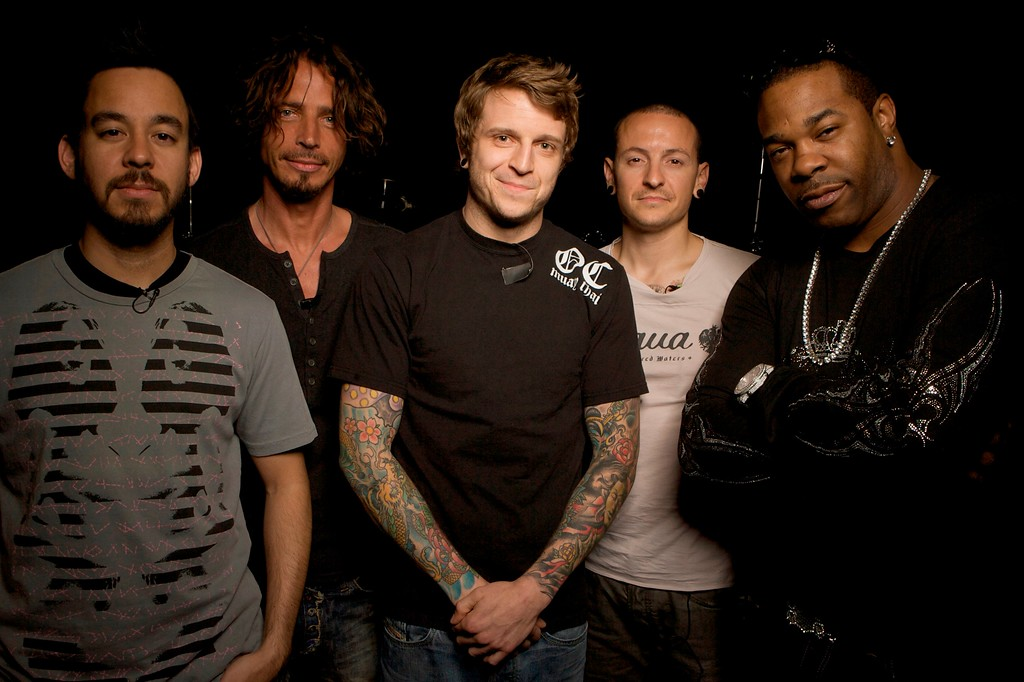 . File - Musicians left to right: Linkin Park co-lead vocalist Mike Shinoda, former Soundgarden/Audioslave vocalist Chris Cornell, Linkin Park co-lead vocalist Chester Bennington, Atreyu vocalist Alex Varkatzas and Jamaican American hip hop musician and actor Busta Rhymes pose for a photo at the Linkin Park band rehearsal studio Thursday, May 29, 2008 in Los Angeles. (AP Photo/Damian Dovarganes)