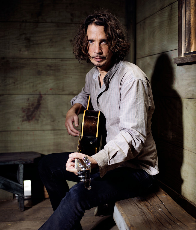 . FILE - In this July 29, 2015 file photo, Chris Cornell plays guitar during a portrait session at The Paramount Ranch in Agoura Hills, Calif. Cornell, 52, who gained fame as the lead singer of the bands Soundgarden and Audioslave, died at a hotel in Detroit on Thursday, May 18, 2017. (Photo by Casey Curry/Invision/AP, File)