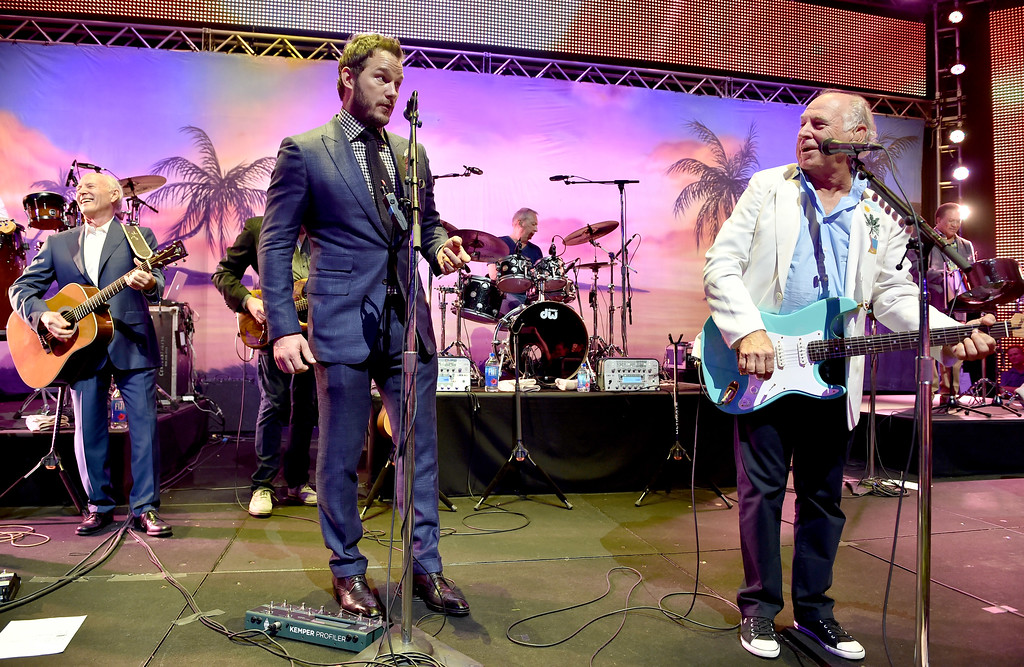 ". LOS ANGELES, CA - JUNE 09:  (L-R) Producer Frank Marshall, actor Chris Pratt and musician Jimmy Buffett perform at the after party for the premiere of Universal Pictures\' ""Jurassic World\"" at Hollywood & Highland on June 9, 2015 in Los Angeles, California.  (Photo by Kevin Winter/Getty Images)"
