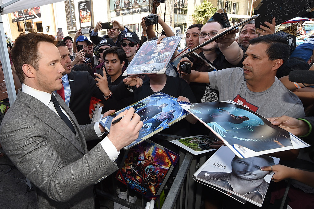 . HOLLYWOOD, CA - APRIL 21:  Chris Pratt signs autographs for fans during the Hollywood Walk Of Fame event honoring him with a star on April 21, 2017 in Hollywood, California.  (Photo by Kevork Djansezian/Getty Images)