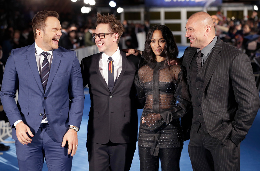 ". Director James Gunn, second left, laughs with American actors, from left, Chris Pratt, Zoe Saldana and Dave Bautista, as they pose for photographers during Japan premiere of ""Guardians of the Galaxy Vol. 2\"" in Tokyo, Monday, April 10, 2017. (AP Photo/Shizuo Kambayashi)"