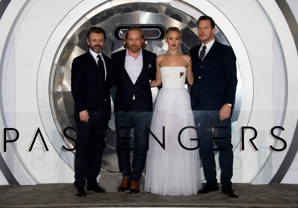 ". (L-R) Actors Michael Sheen, director Morten Tyldum, actors Jennifer Lawrence and Chris Pratt attend the premiere of ""Passengers\"", in Westwood, California, on December 14, 2016. (VALERIE MACON/AFP/Getty Images)"