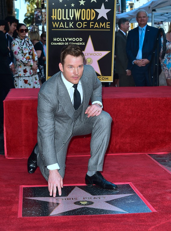 . Actor Chris Pratt poses at his Hollywood Walk of Fame Star on April 21, 2017 in Hollywood, California where he was the recipient of the 2,607th Star in the category of Motion Picture. / AFP PHOTO / FREDERIC J. BROWN        (Photo credit should read FREDERIC J. BROWN/AFP/Getty Images)