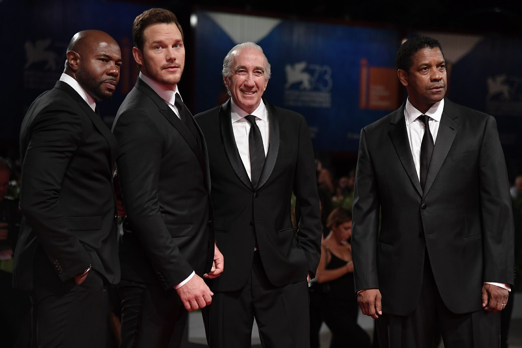 ". Director and executive producer Antoine Fuqua (L), actor Chris Pratt (2ndL) and actor Denzel Washington (R) attend the Premiere of the movie ""The Magnificent Seven\"" following the ceremony awards at the 73rd Venice Film Festival on September 10, 2016 at Venice Lido. (TIZIANA FABI/AFP/Getty Images)"