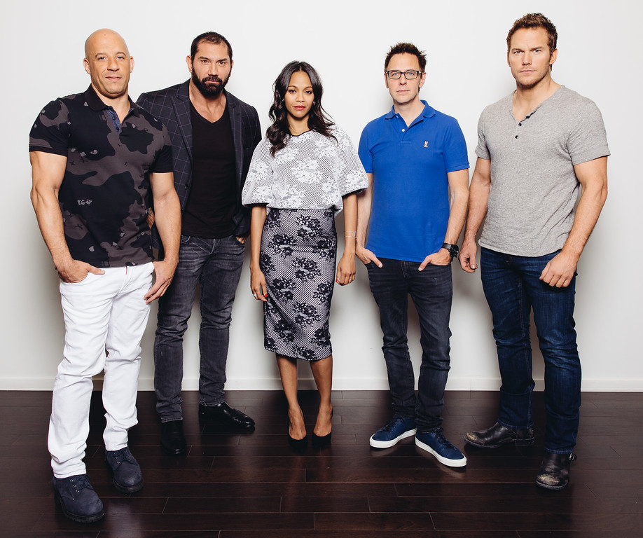 ". In this Saturday, July 19, 2014 photo, from left, guardian cast members, Vin Diesel, Dave Bautista, Zoe Saldana, director James Gunn, and Chris Pratt pose for a portrait at Disney Studios during press day for ""Guardians of the Galaxy,\"" in Burbank, Calif. The movie releases on Friday, Aug. 1, 2014.  (Photo by Casey Curry/Invision/AP)"